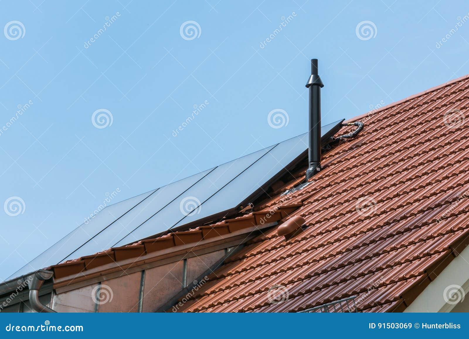 German house orange ceramic tiles solar water heater blue sky su royalty free stock photo dailygadgetfo Choice Image