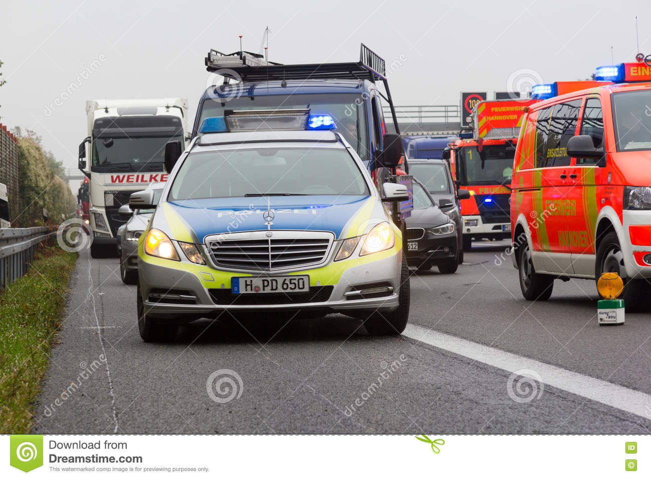 German police car stands on freeway a2 by a truck crash near Hannover.