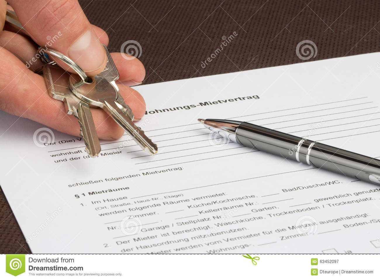 German Rental Agreement With House Keys In One Hand Stock Image ...