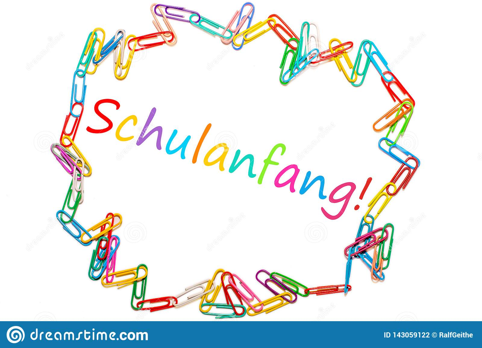 The German word for `Back To School` framed by colorful paper clips