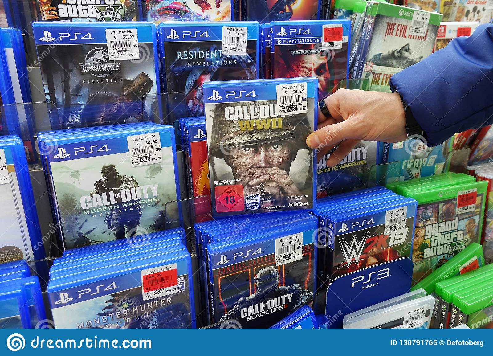 PS4 games in a store editorial image  Image of covers