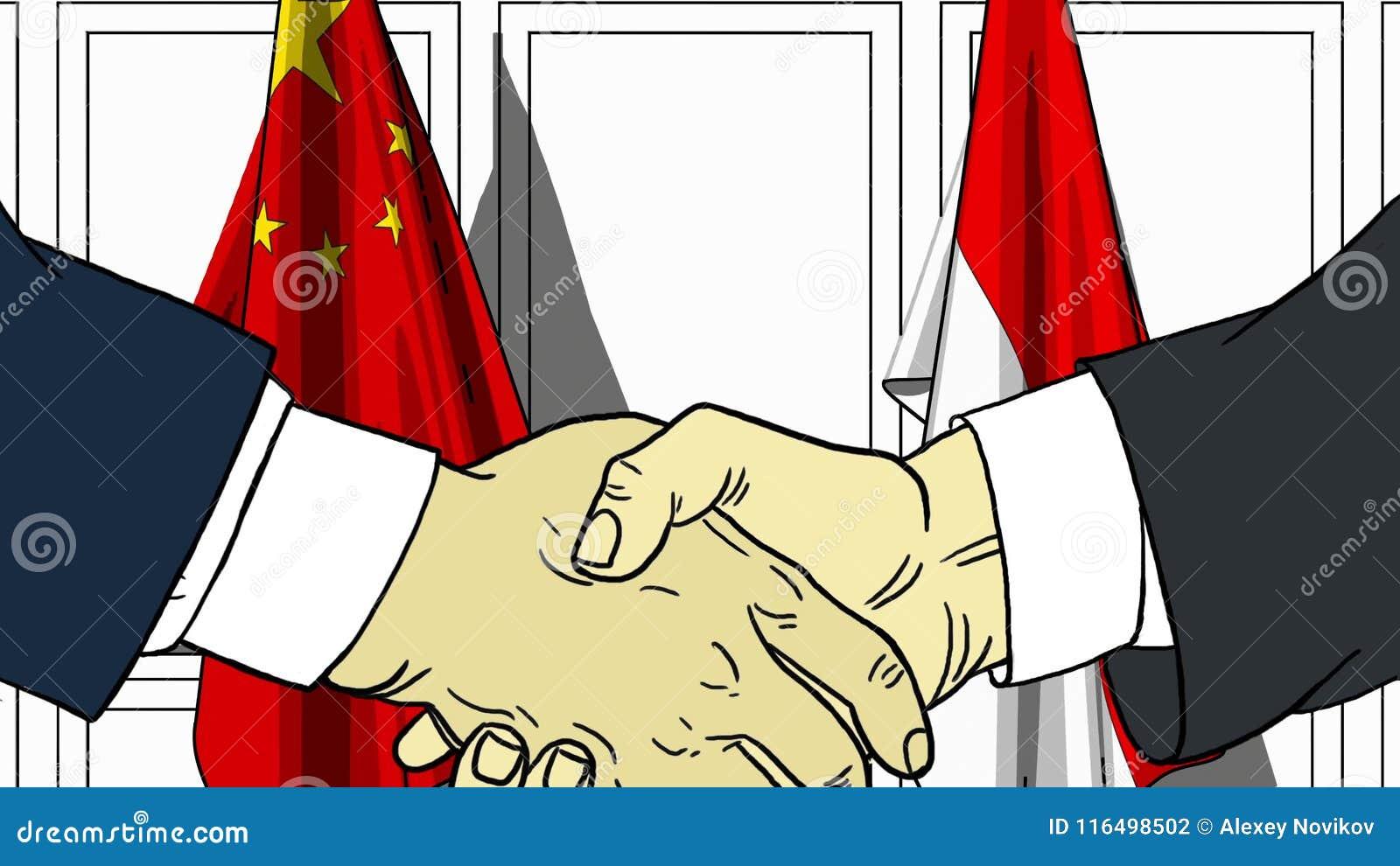 Geschäftsmänner oder Politiker, die Hände gegen Flaggen von China und von Indonesien rütteln Sitzung oder in Verbindung stehende