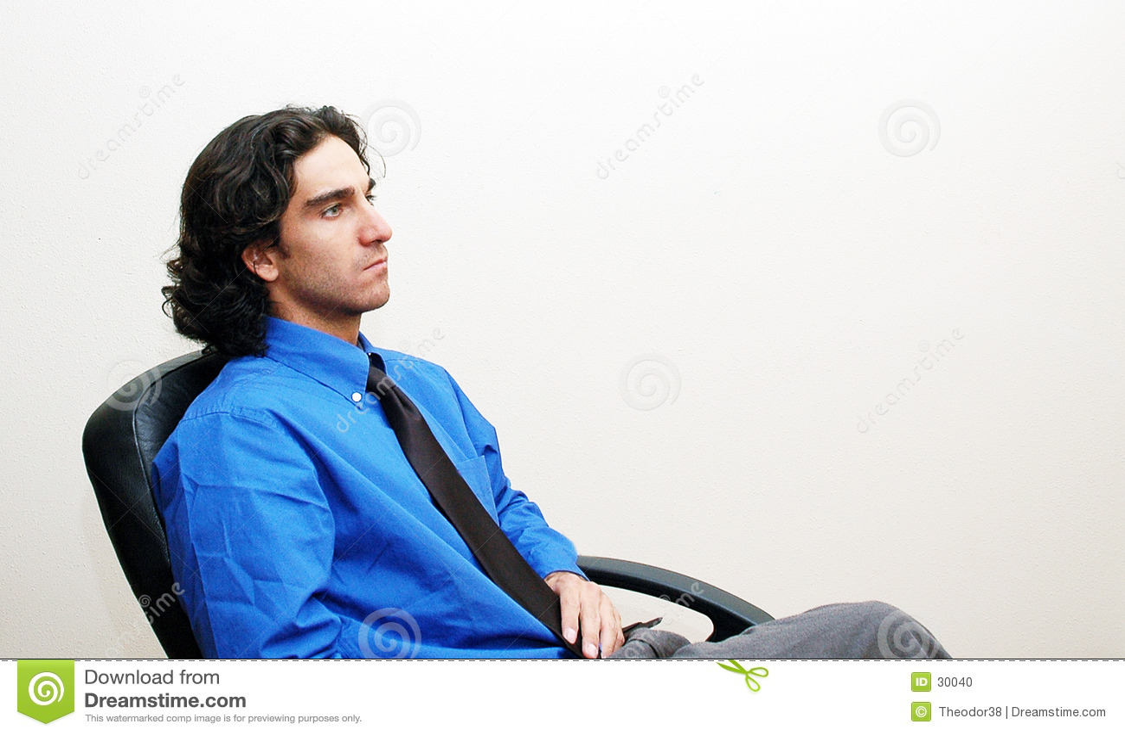Geschäftsmann in einem Stuhl
