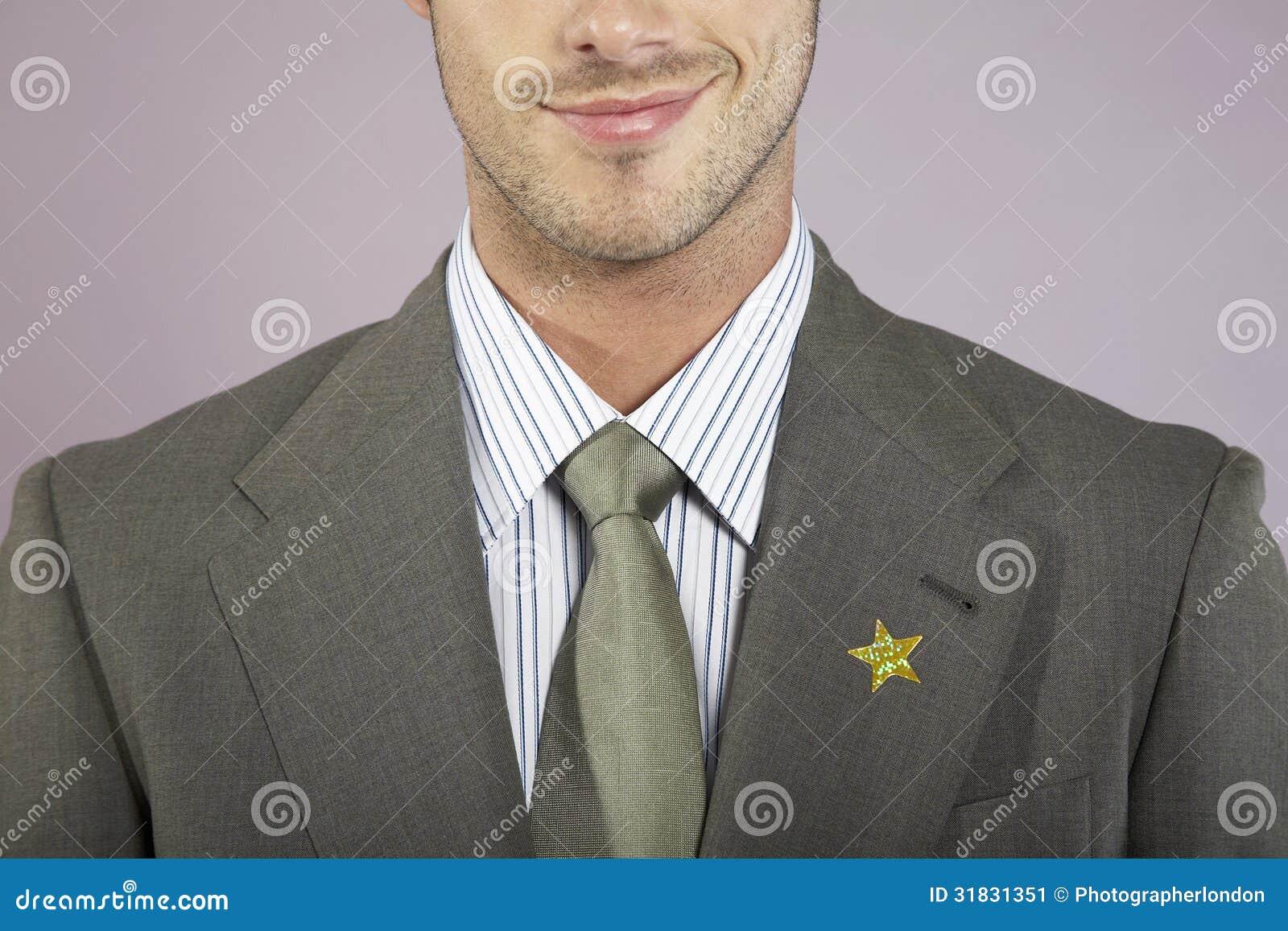 Geschäftsmann With Gold Star auf Klage