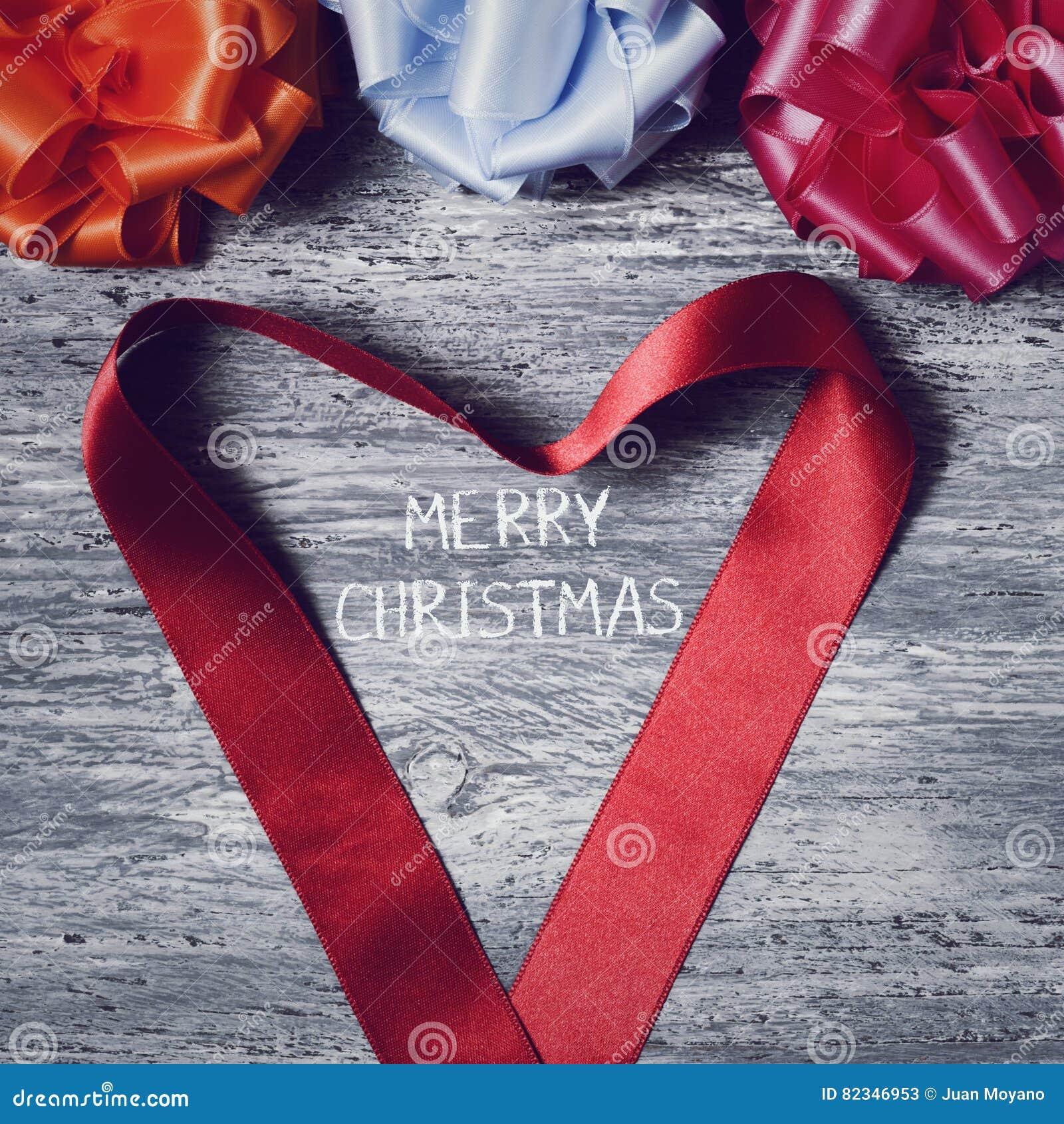 Geschenkband Frohe Weihnachten.Geschenkbandbogen Und Frohe Weihnachten Des Textes Stockbild