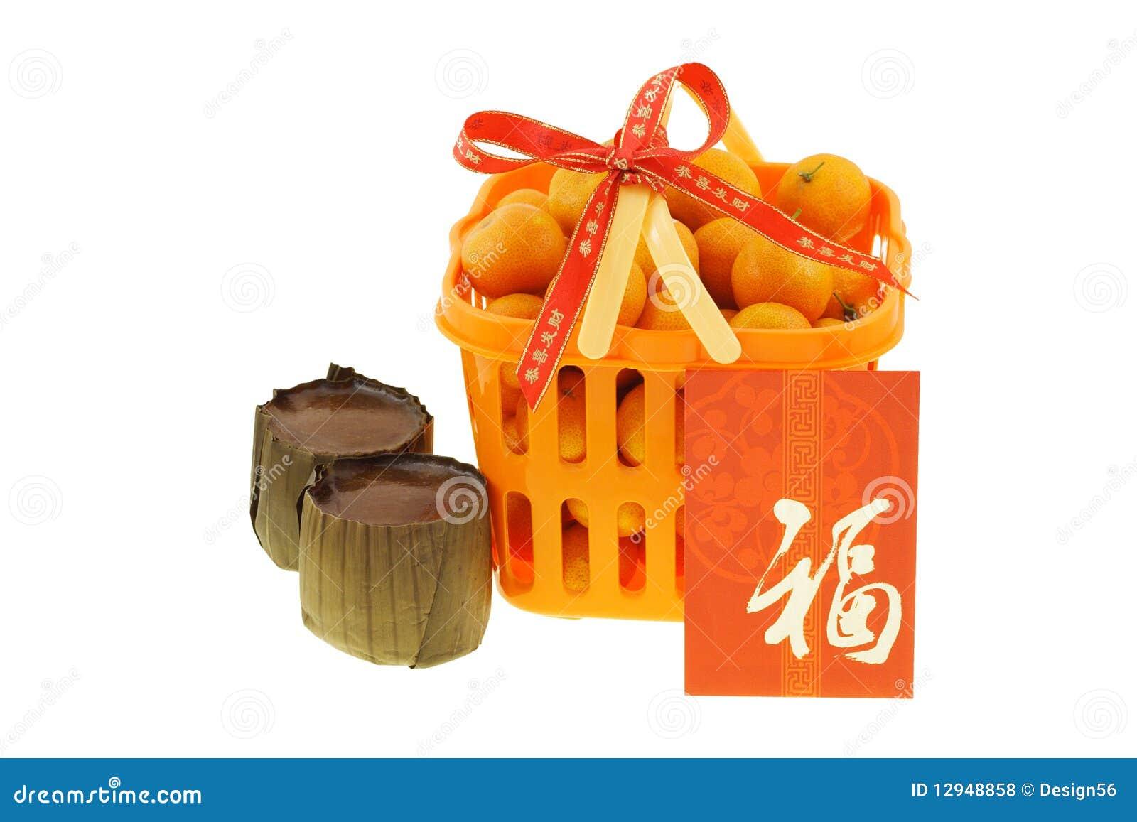 Geschenkkorb Der Mandarinen Und Der Reiskuchen Stockfoto - Bild von ...