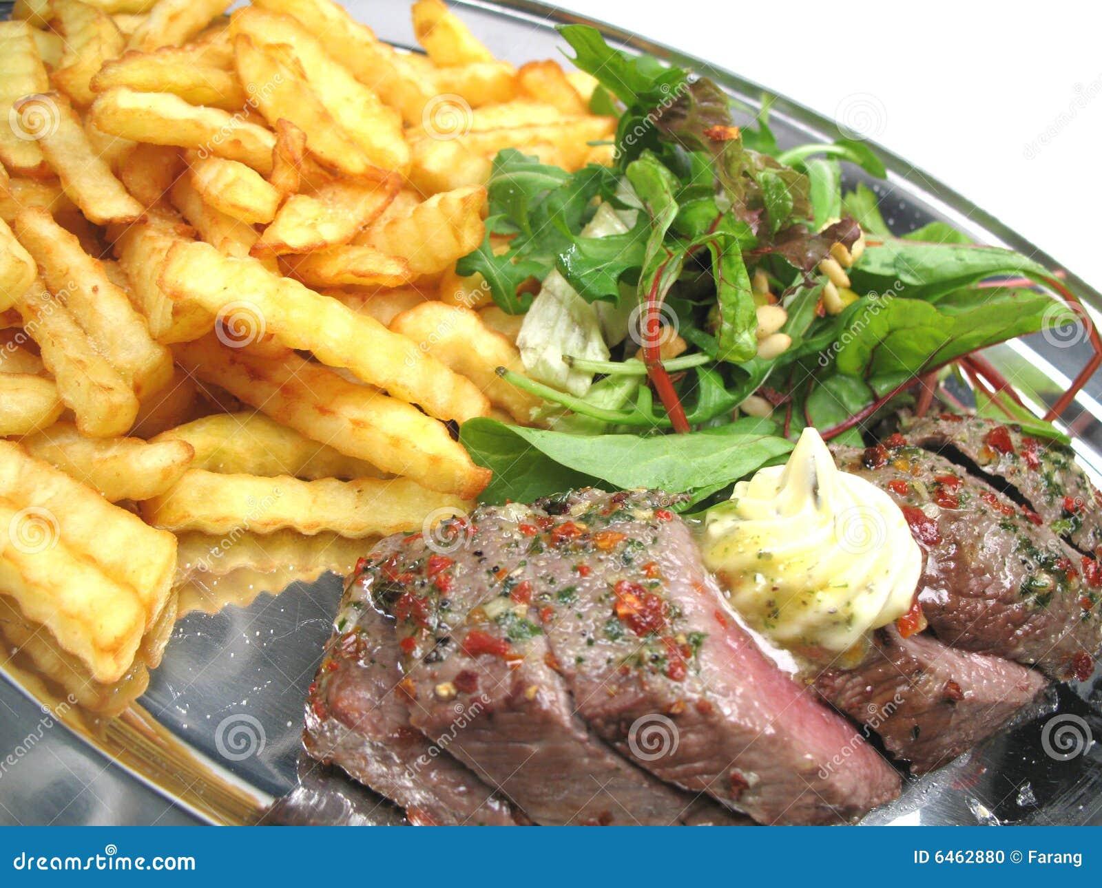 Geschnittenes Steak auf einem Tellersegment