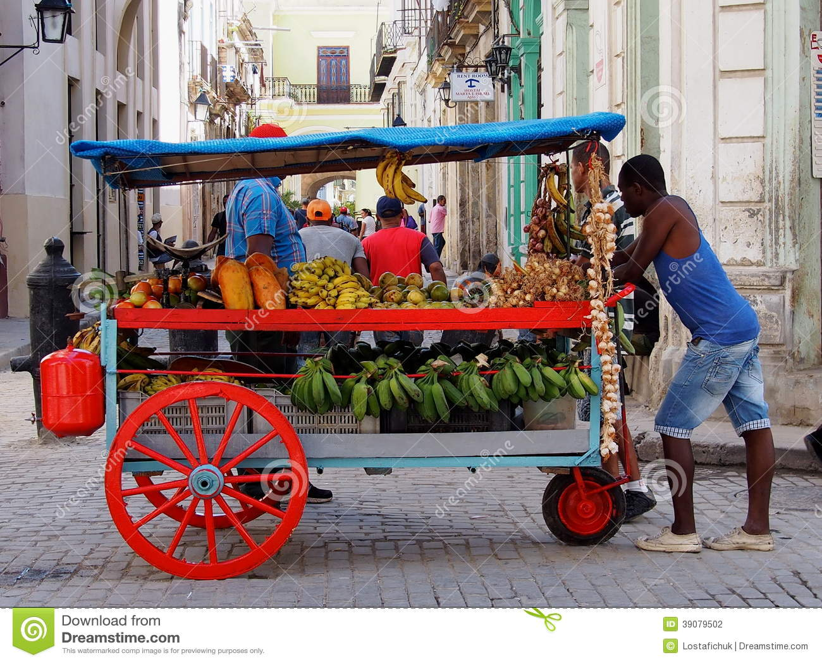 Gesichter des Kuba-Frucht-Warenkorb-Verkäufers