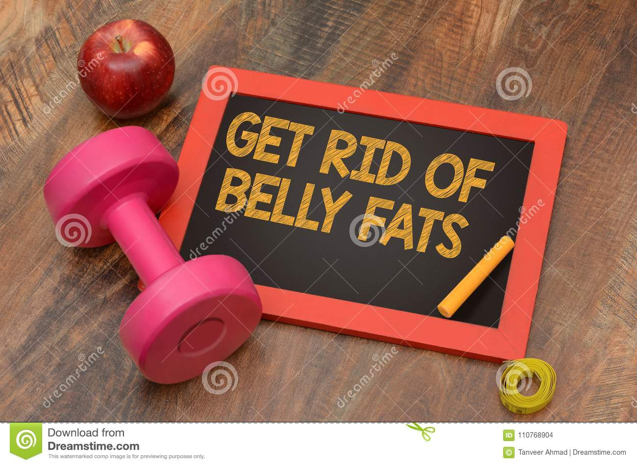 Get rid of Belly fats fitness concept with dumbbell and apple