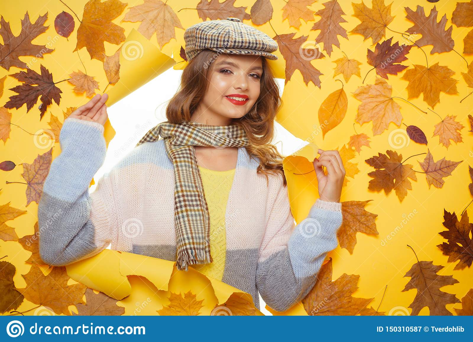 Getting ready for autumn season. Casual fashion trends for fall. Pretty woman wear autumn fashion accessories. Fashion