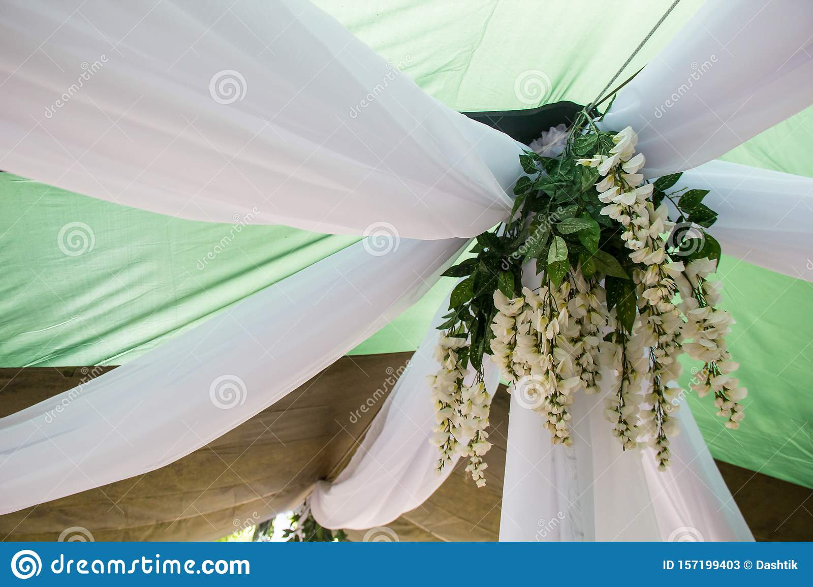Getting Ready For The Wedding Ceremony Decor Of White Wisteria