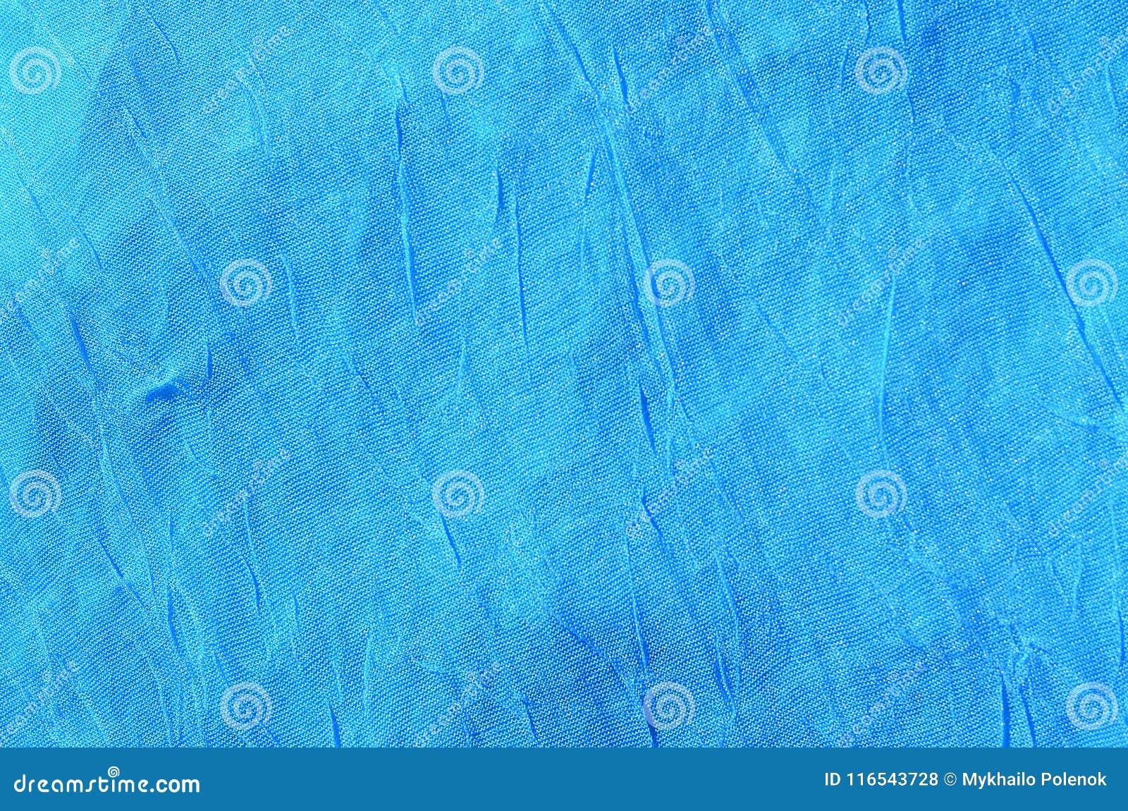 Gevouwen blauw doek materieel fragment als achtergrond textur