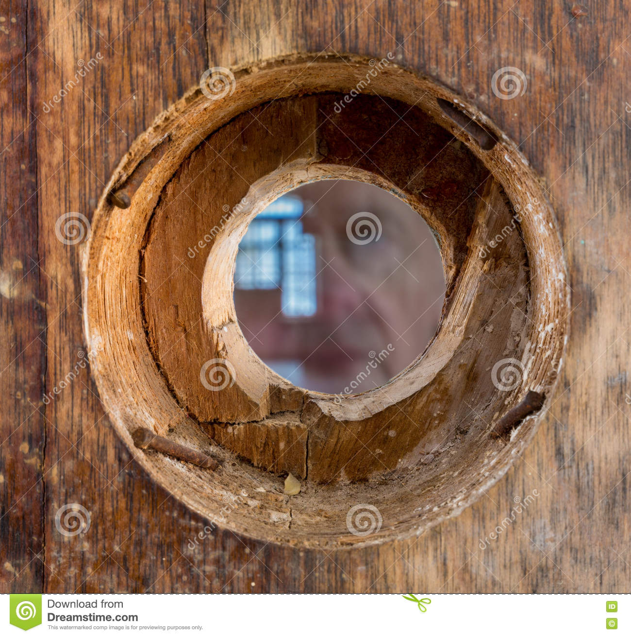 Ghostly Face And Eye Looking Through Peephole Royalty Free