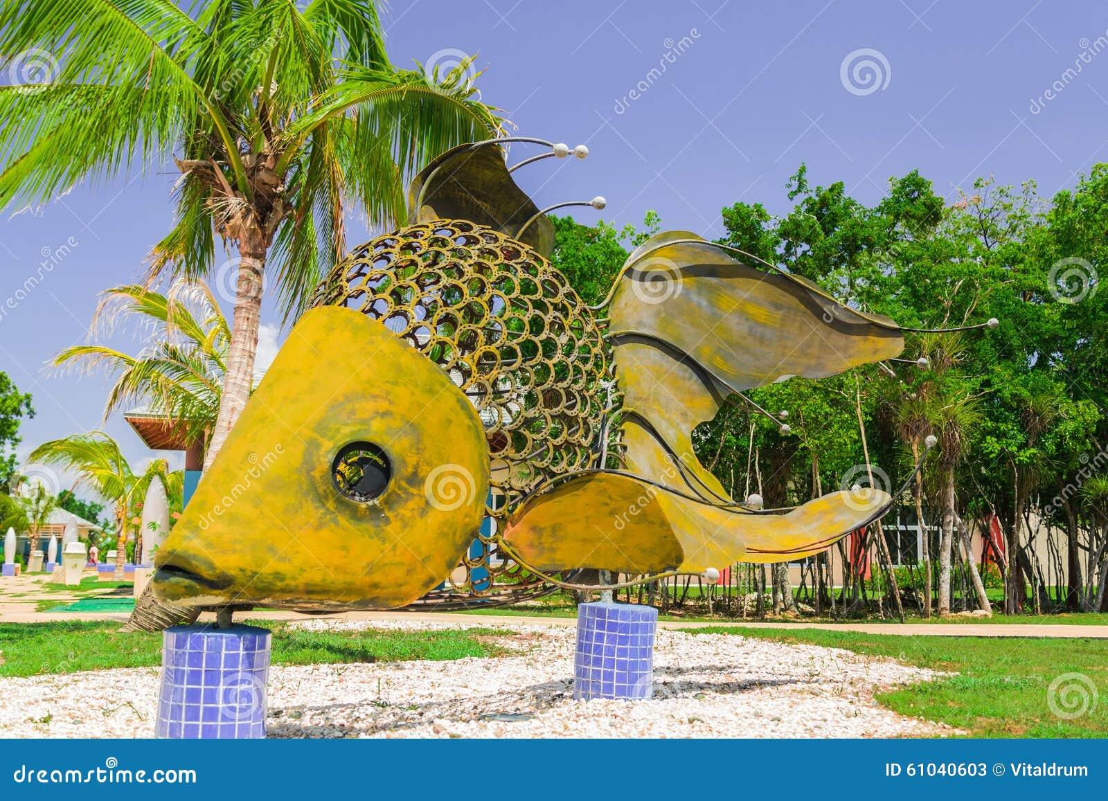 giant big, decorative beutiful fish made of metal and horshoe