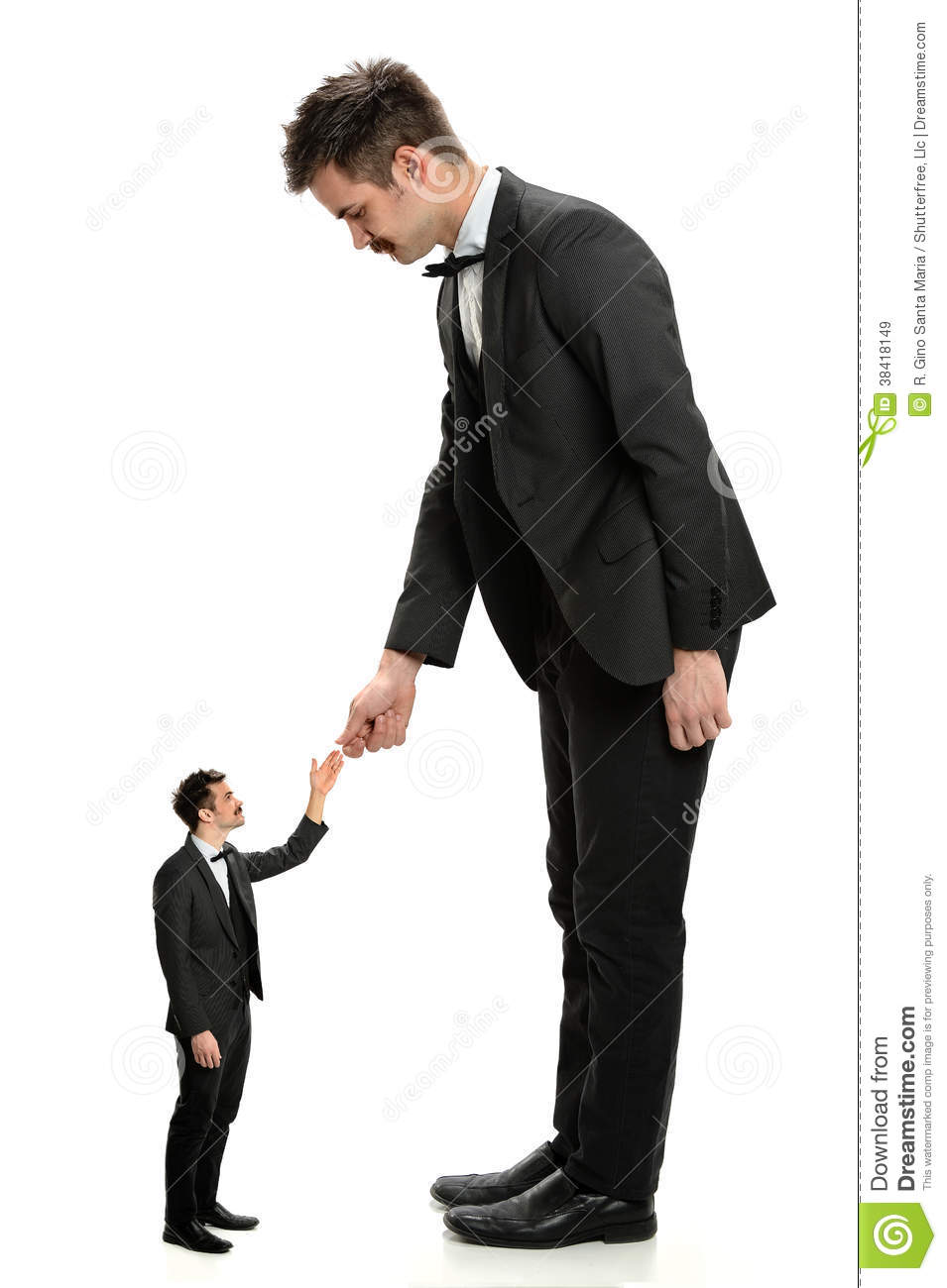 Giant businessman shaking hands with small businessman isolated over ...