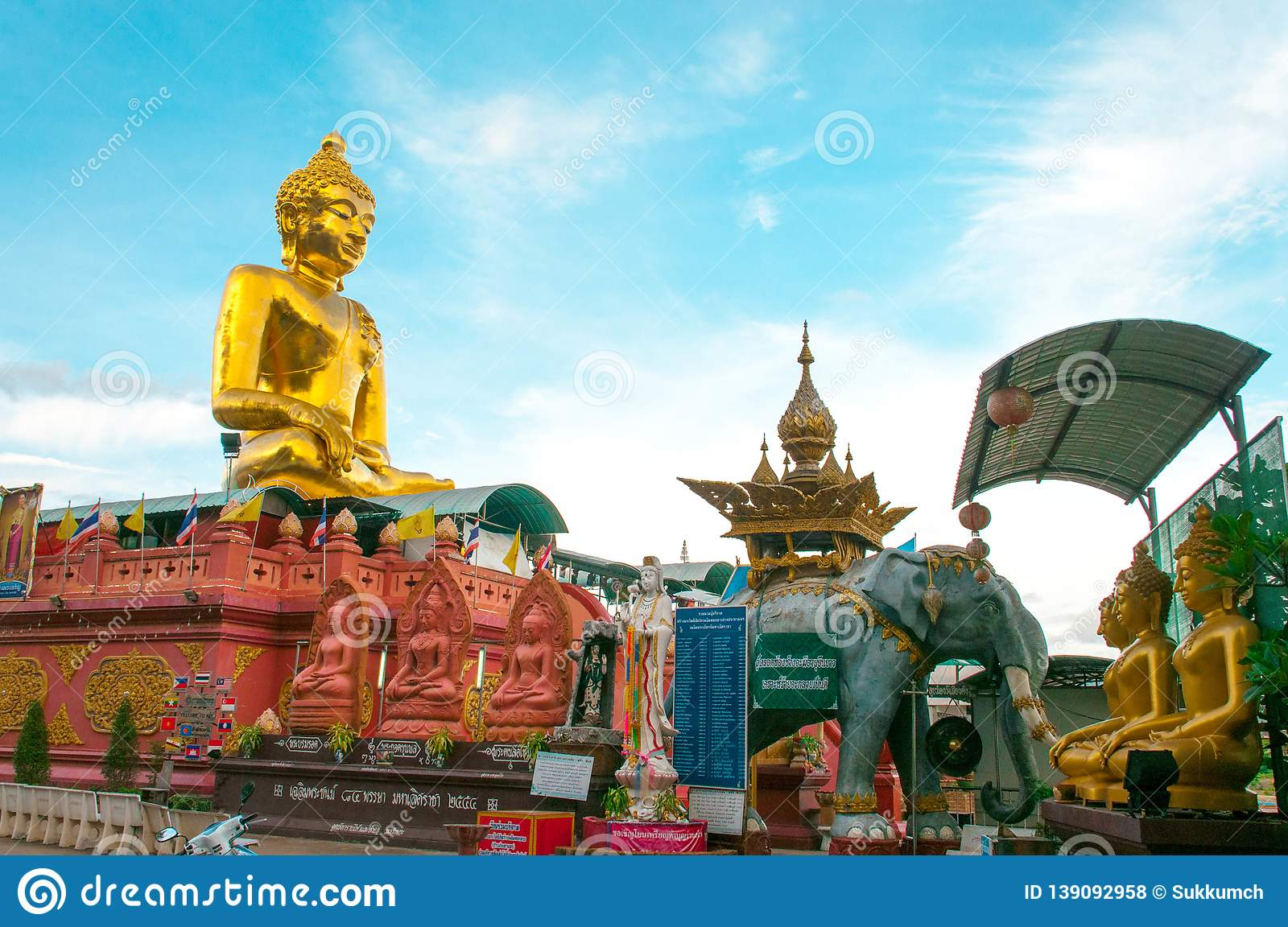 Giant Golden Buddha statue with blue sky Thailand