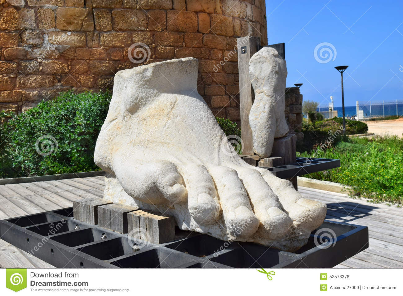 Giant human foot carved from a stone in caesarea maritima