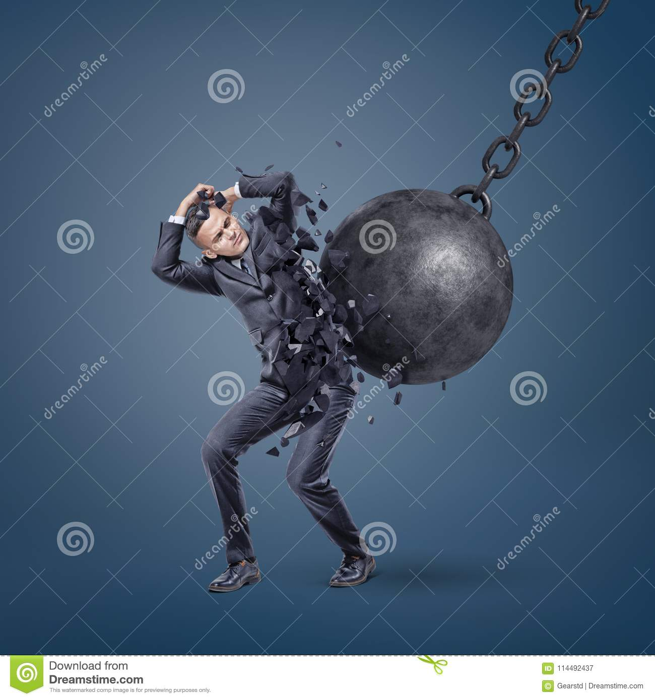 A giant wrecking ball hits a scared businessman and breaks him in pieces.