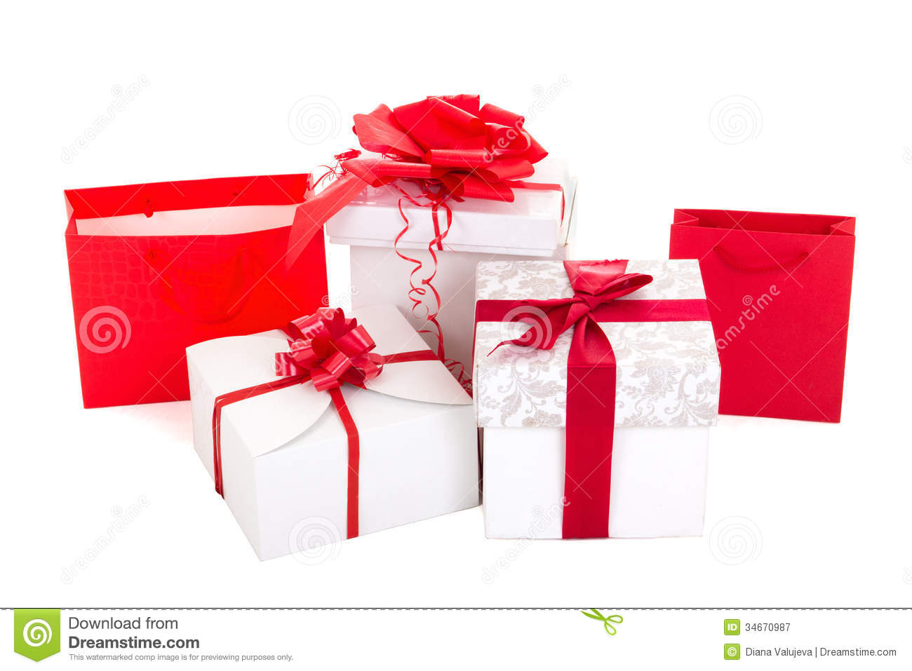 Gift bags and boxes with red ribbon on white background