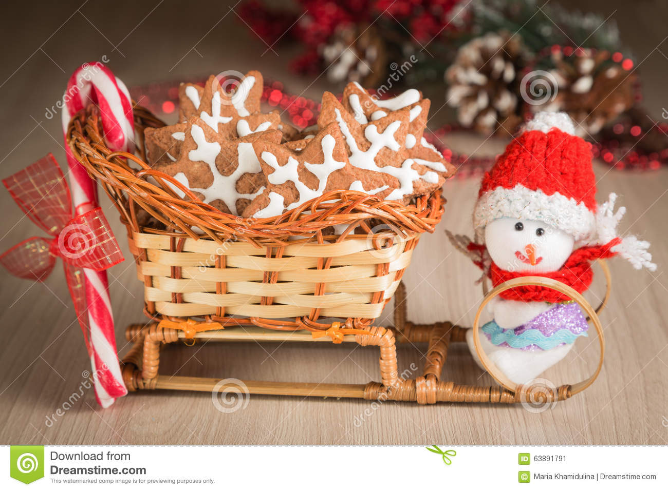 Gift Basket Sleigh With Cookies Candy And A Toy Snowman Dressed In