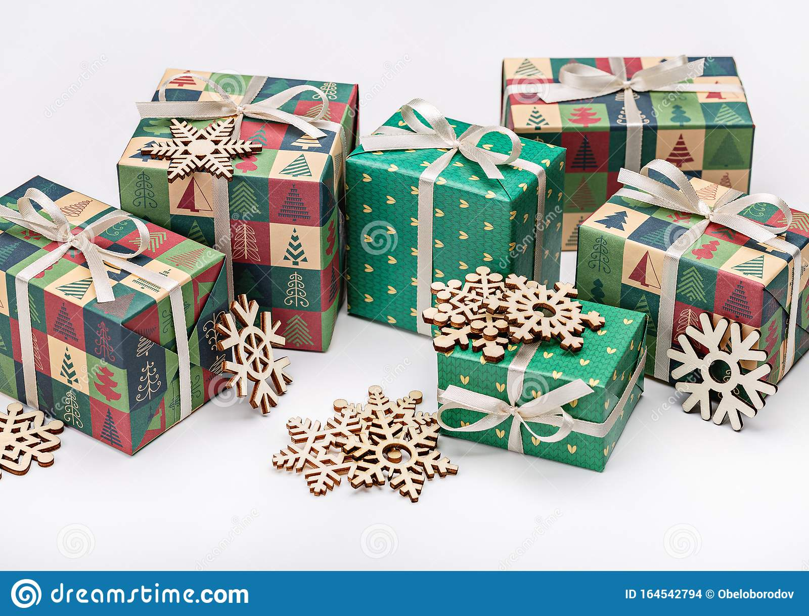 Gift Beautiful Boxes In Elegant Christmas Paper With Christmas Trees Tied With Ribbon With Bow On Light Background Concept Of Stock Photo Image Of Finish Drawing 164542794