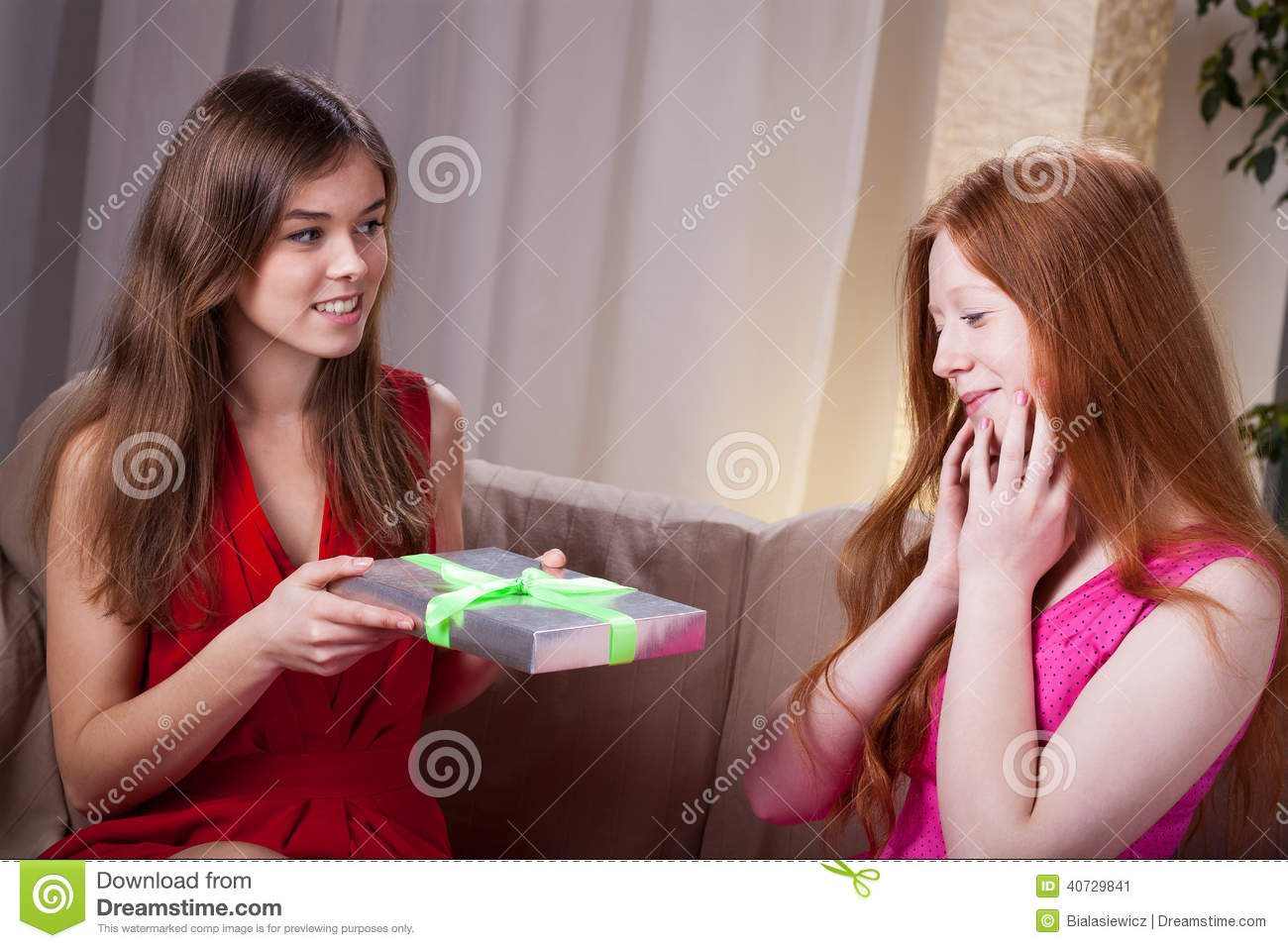 Woman Giving Her Best Friend Gift For Birthday