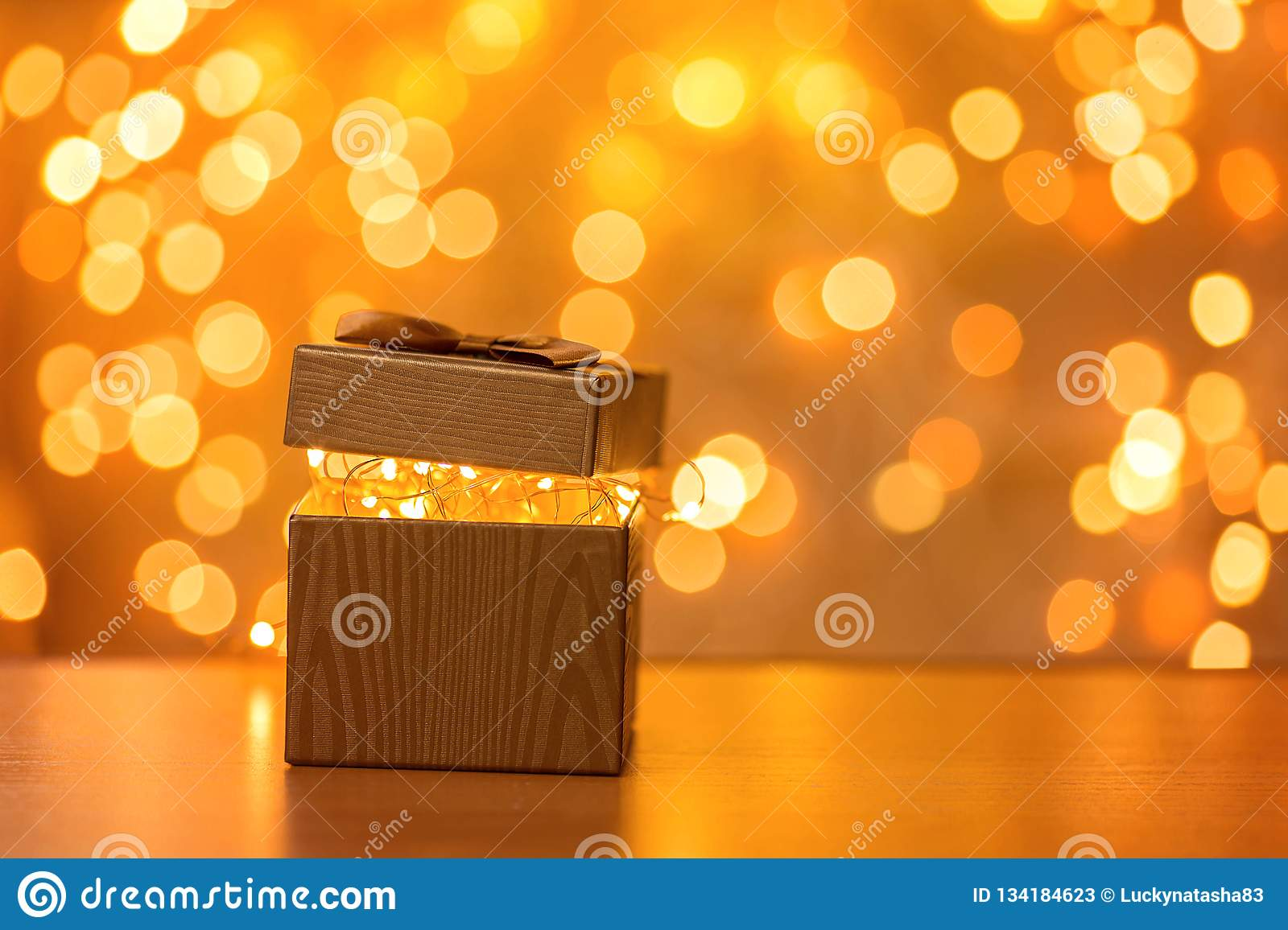 Gift on blurry New Year lights background