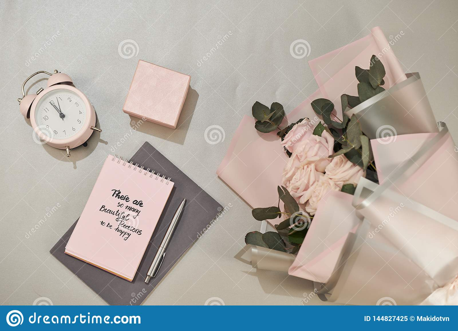 Gift box, alarm clock and pink rose flowers. Greeting card for Mother or Woman day