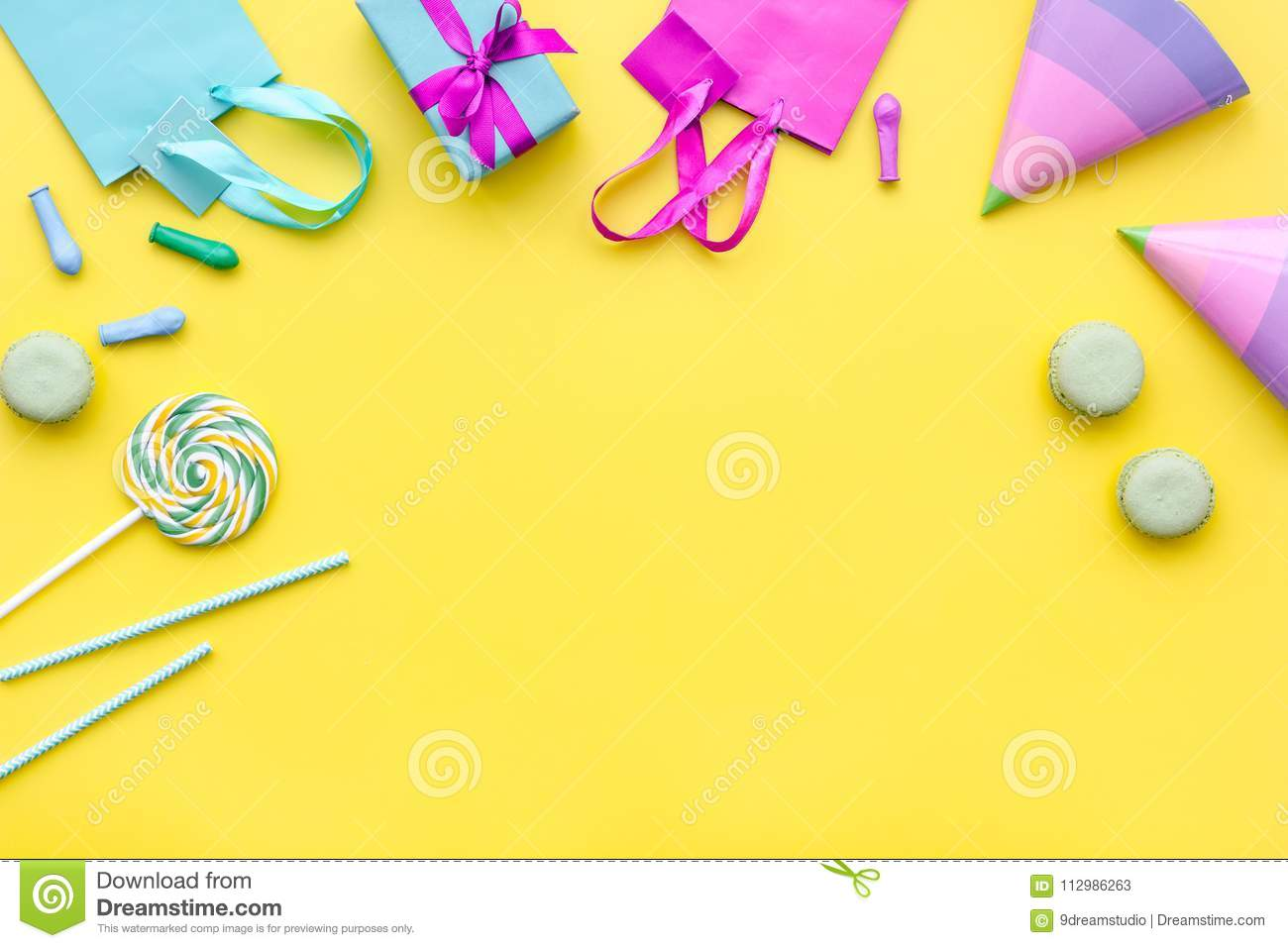 Gift box and colorful paper bag on yellow background top view space for text