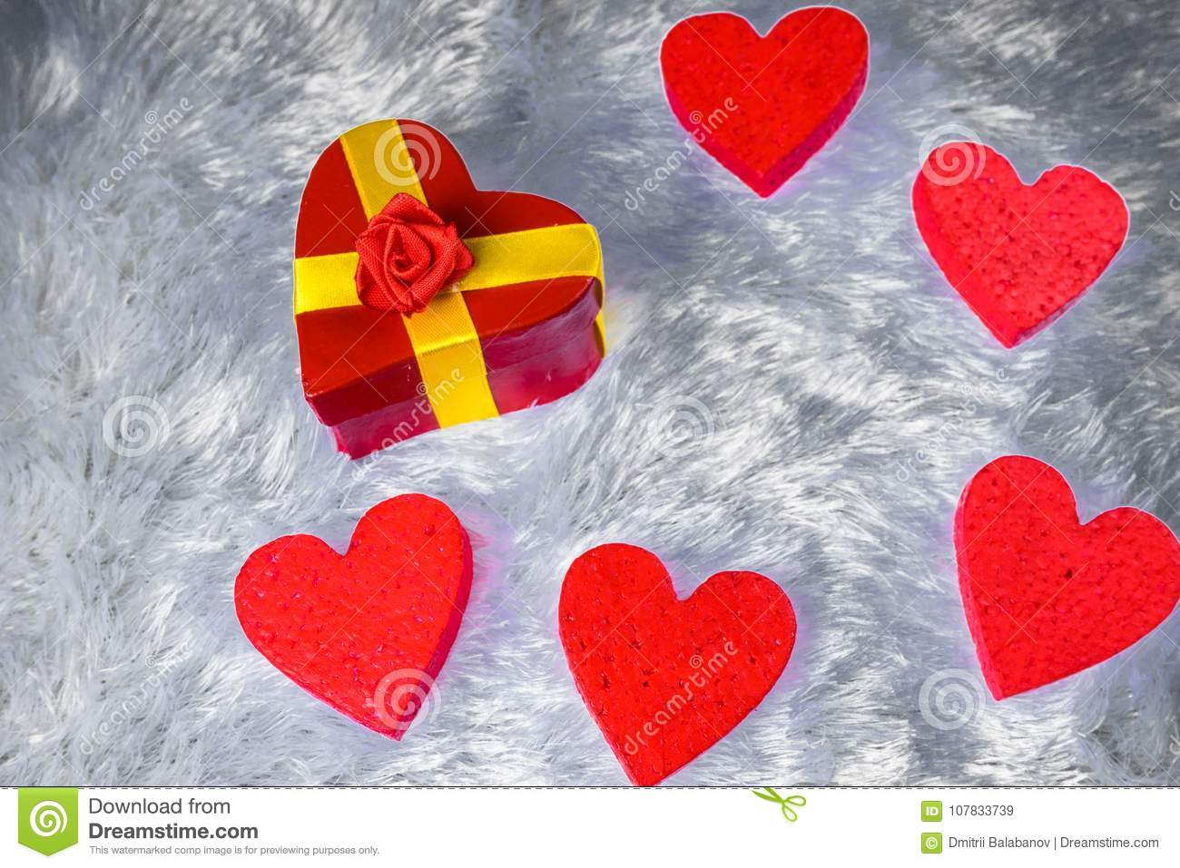 Gift Box In Heart Shape Surrounded By Decorative Hearts On