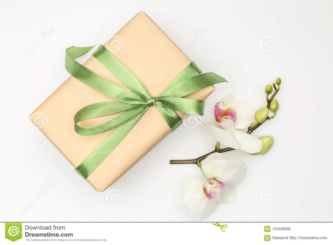 Gift Box With Orchid Flower On White Background Stock Photo Image