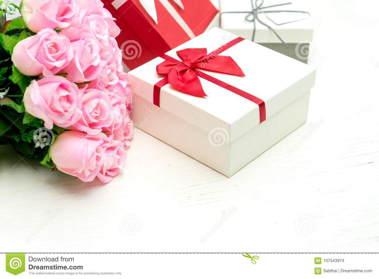 Gift Box With Pink Rose Flower For Lover Valentine Stock Photo