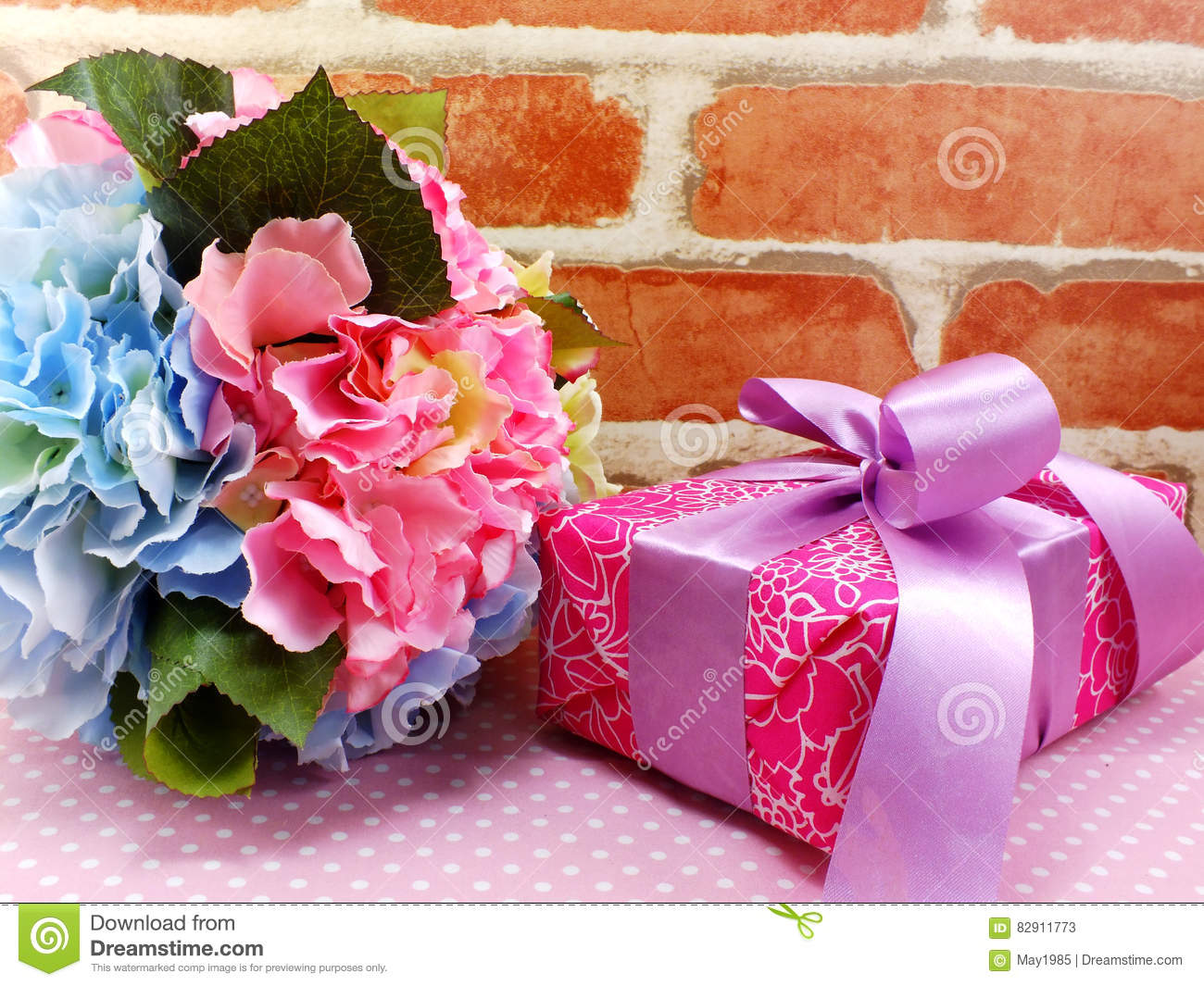 Gift box present with pink ribbon bow and beautiful flowers gift box present with pink ribbon bow and beautiful flowers background stock image image of celebration bouquet 82911773 izmirmasajfo