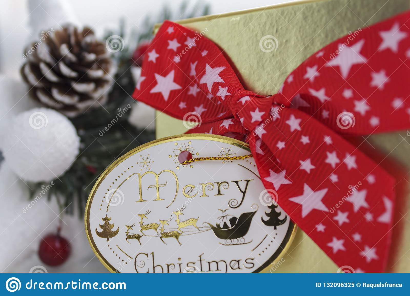 Gift box with red bow and merry christmas card