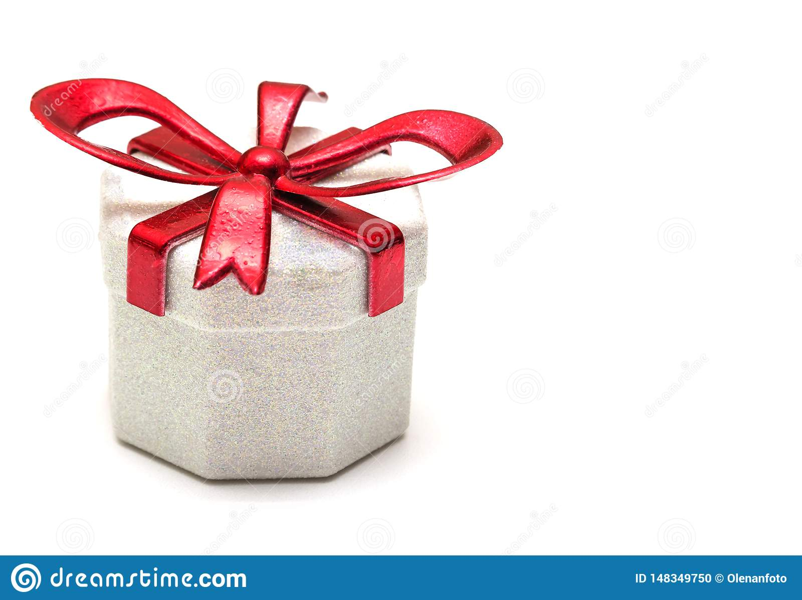 Gift box with a red ribbon on a white background