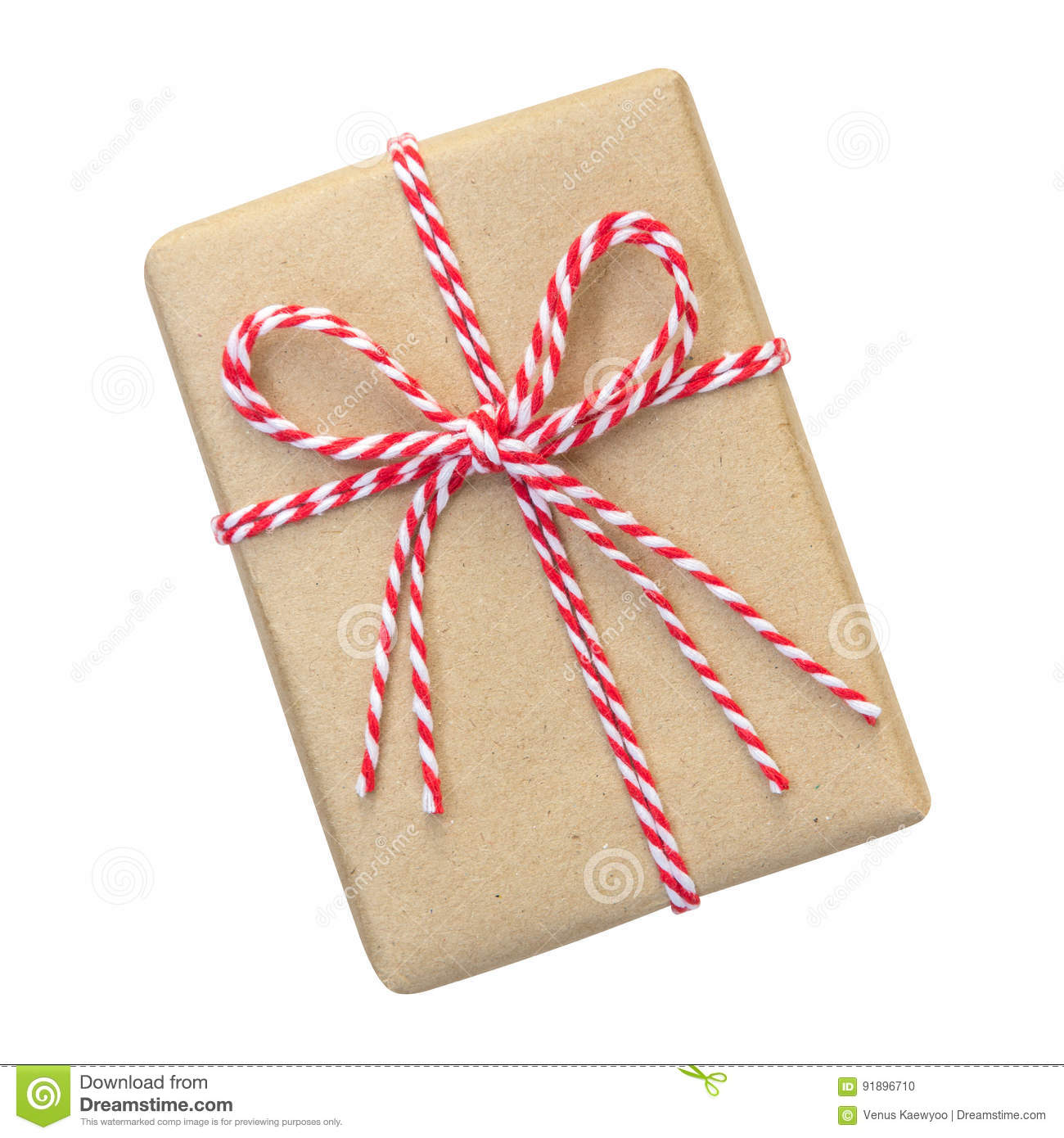 Gift box wrapped in brown recycled paper with red and white rope