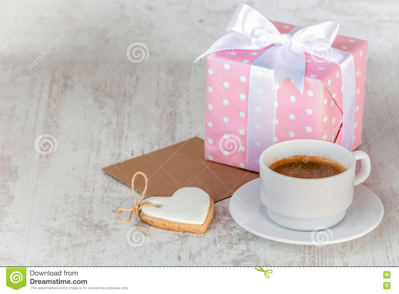 Download Gift Box Wrapped In Pink Dotted Paper, Heart Shaped Love Cookie, A Cup Of Coffee And An Empty Kraft Card Over A White Wood Backgro Stock Photo - Image of message, baby: 81533188