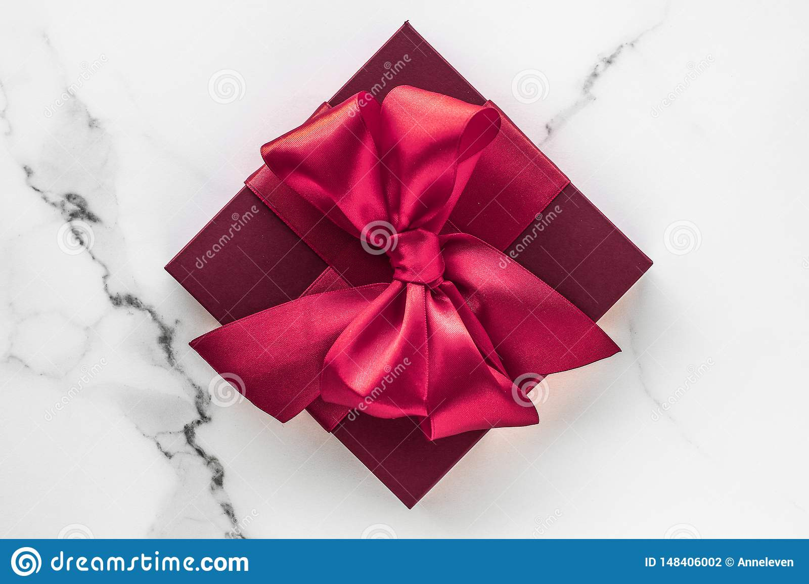 Gift boxes on marble background, holiday flatlay