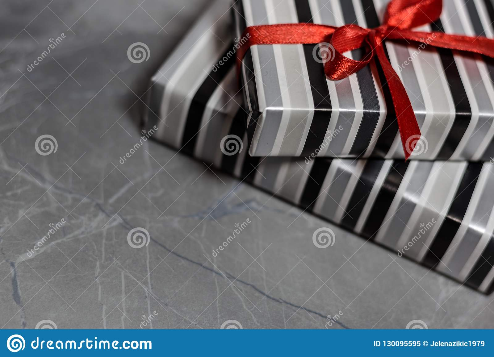 Gift boxes with a red ribbon