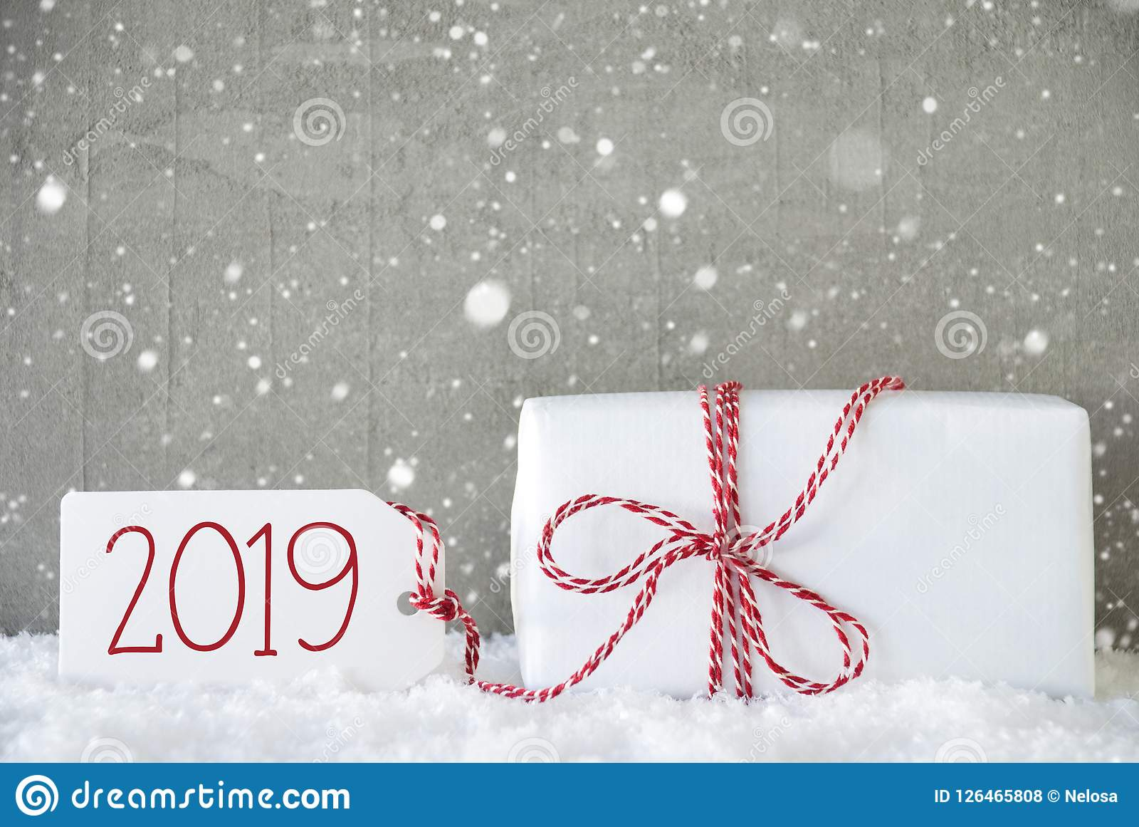 Is It Going To Snow On Christmas 2019 Gift, Cement Background With Snowflakes, Text 2019, Snow Stock