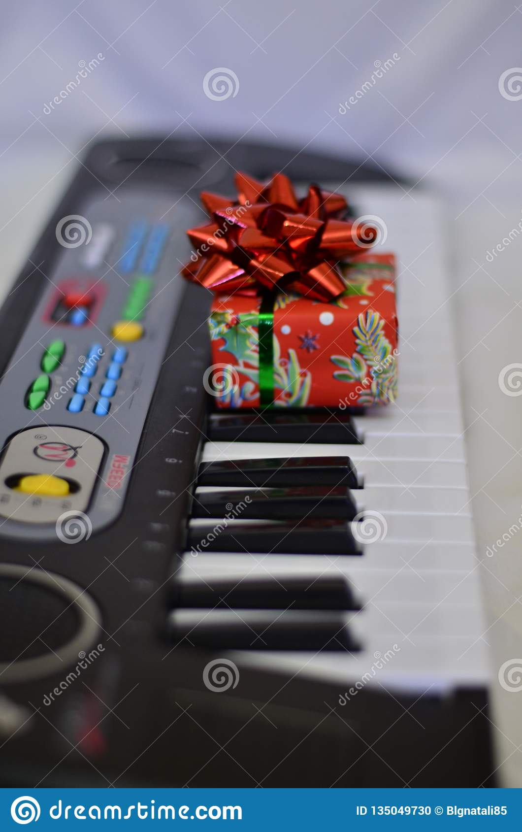 Gift close-up on synth keys with a soft blurred background