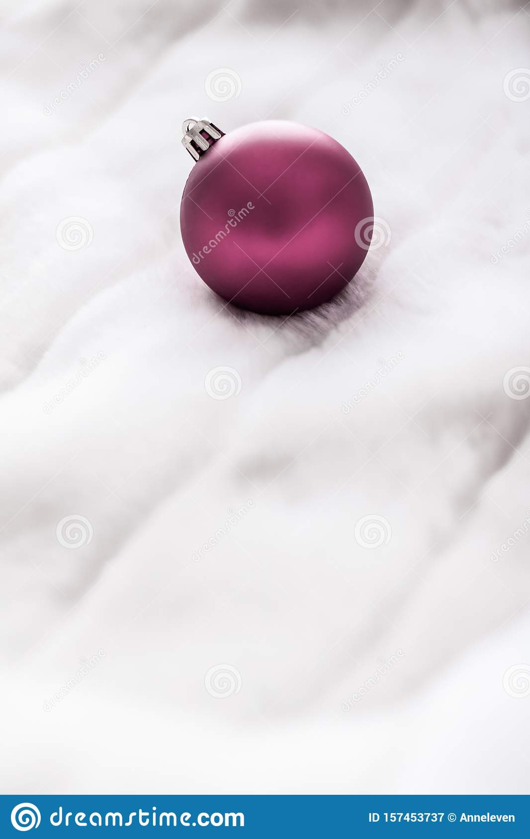 Purple Christmas baubles on white fluffy fur backdrop, luxury winter holiday design background