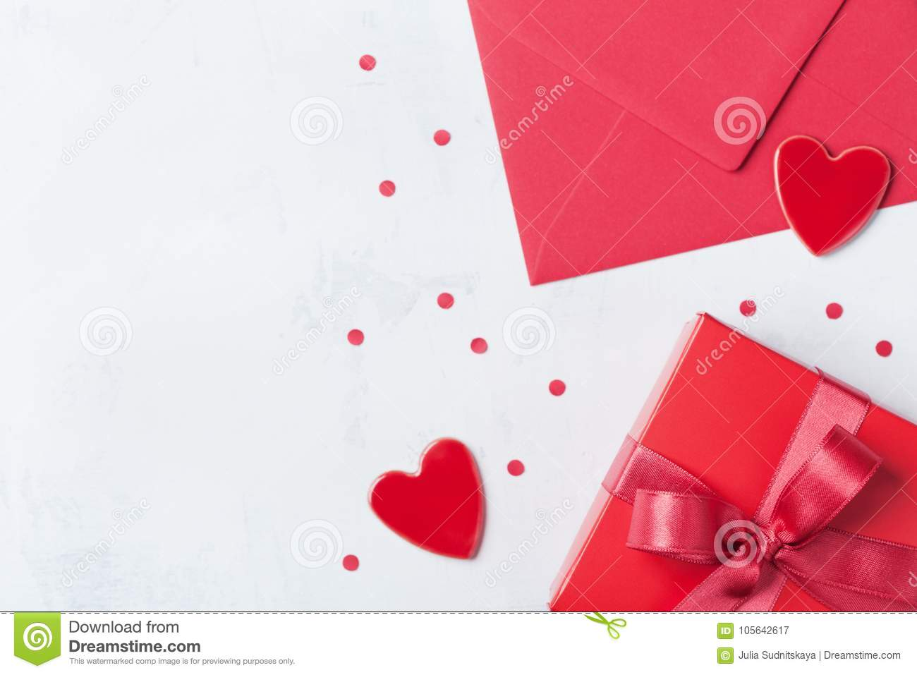 Gift, envelope and red heart on white table for greeting on Valentines Day. Flat lay.