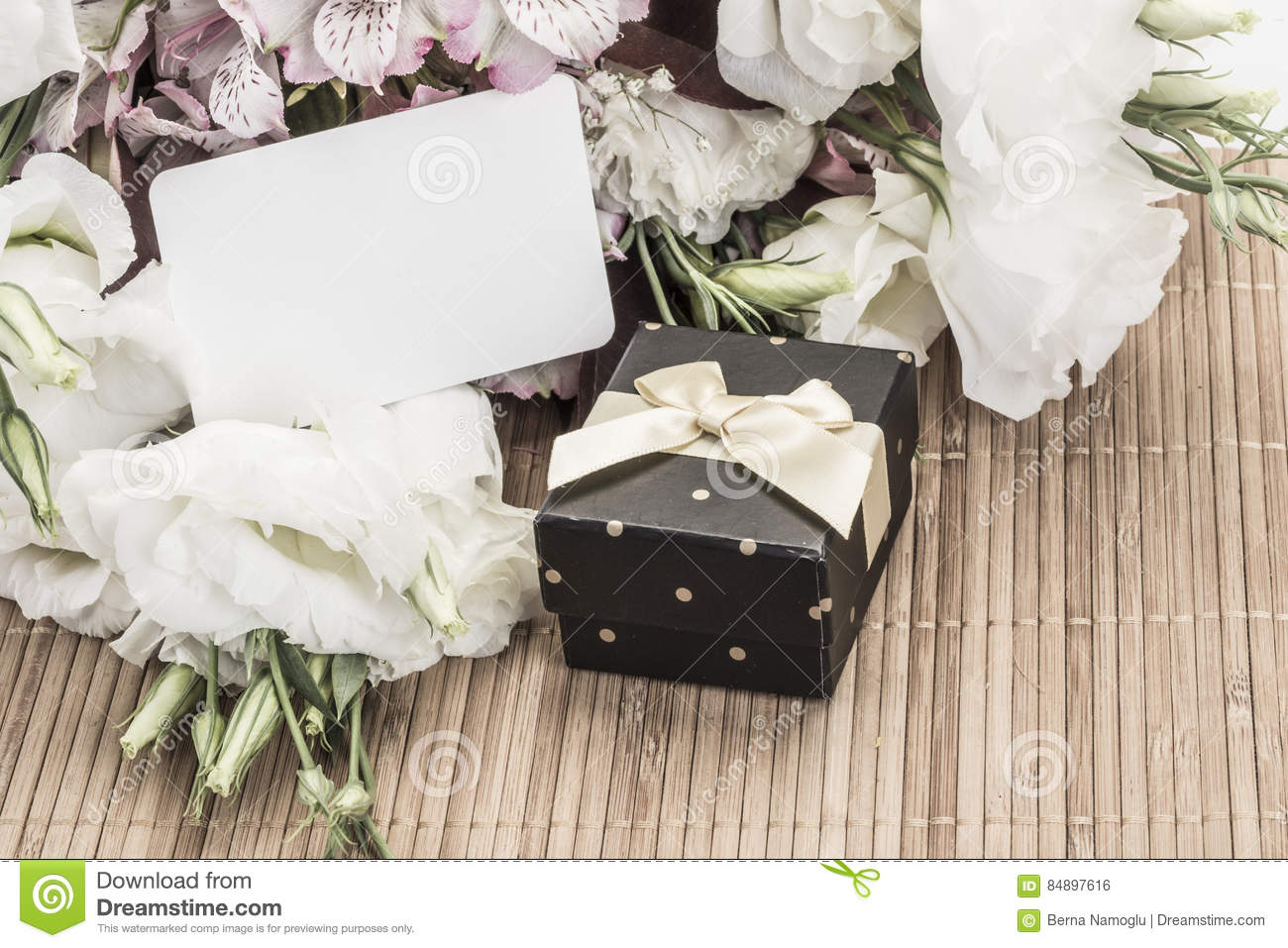 A Gift Box And Flowers With An Empty Name Tag