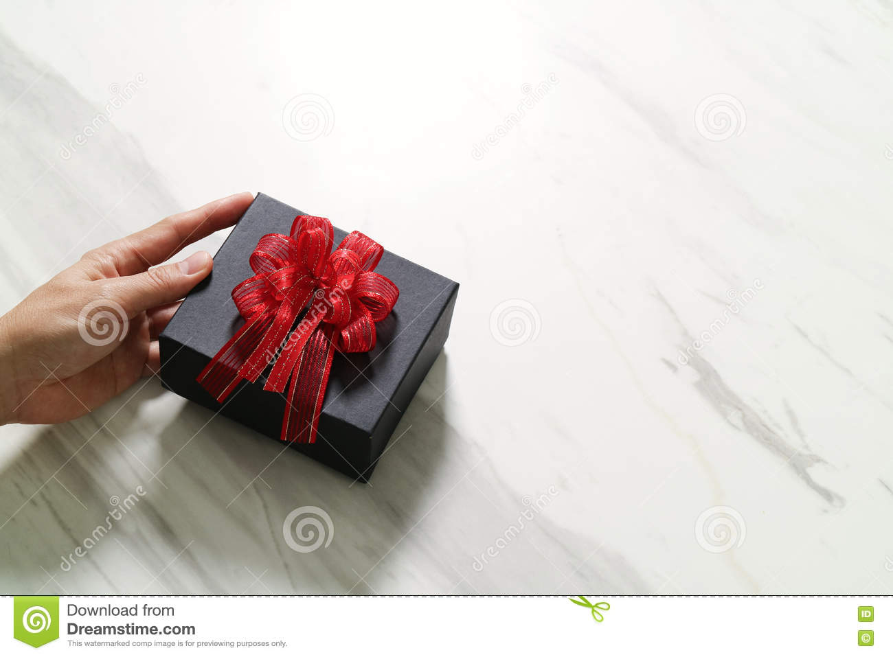 gift giving,man hand holding a gift box in a gesture of giving o