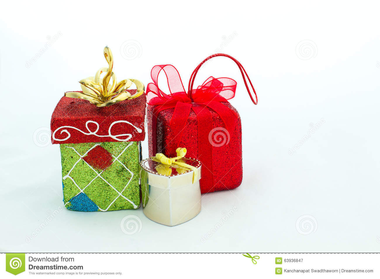 Gift packages and christmas colored accessories isolated on white