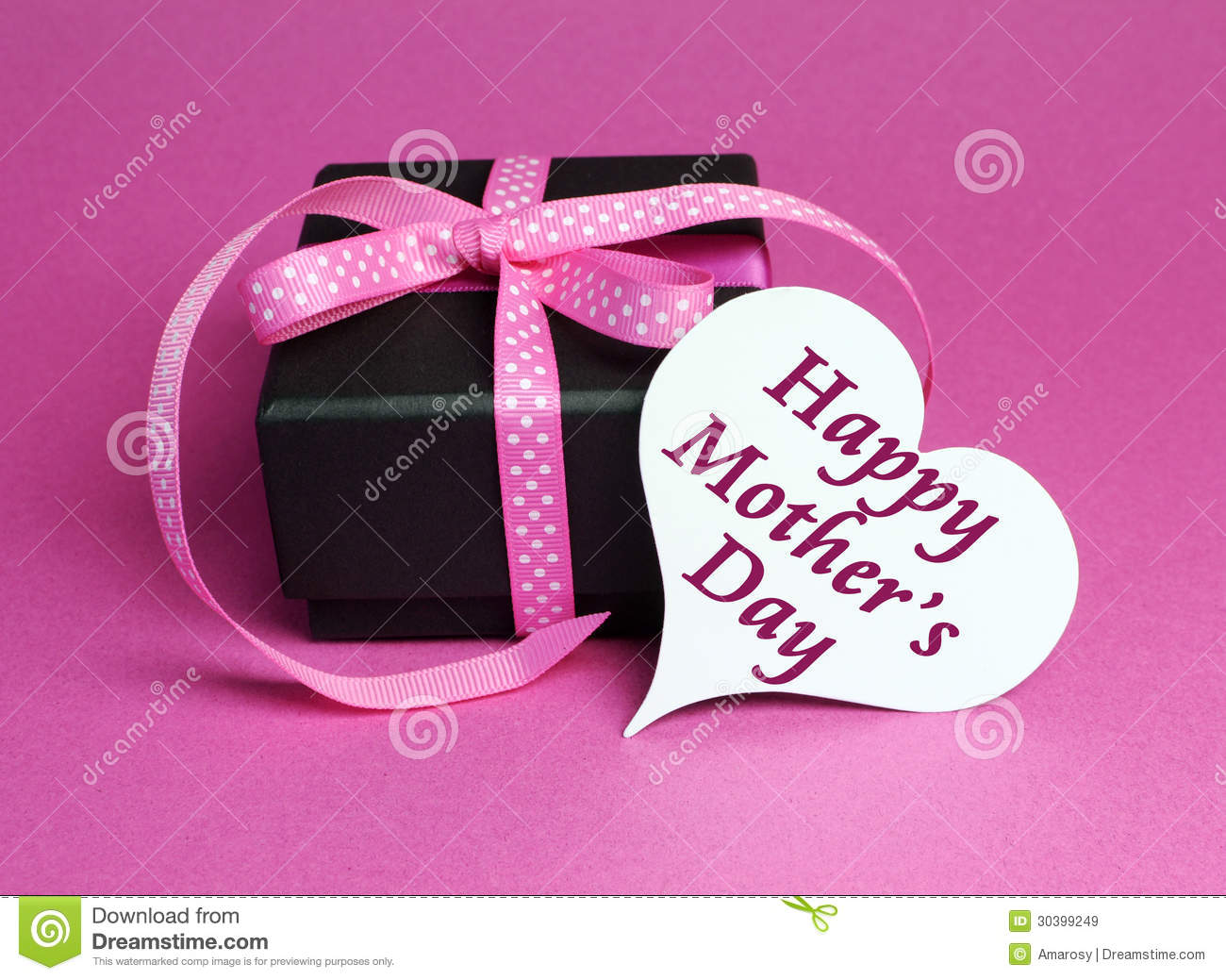 Gift with pink polka dot ribbon and white heart shape gift tag with Happy Mothers Day