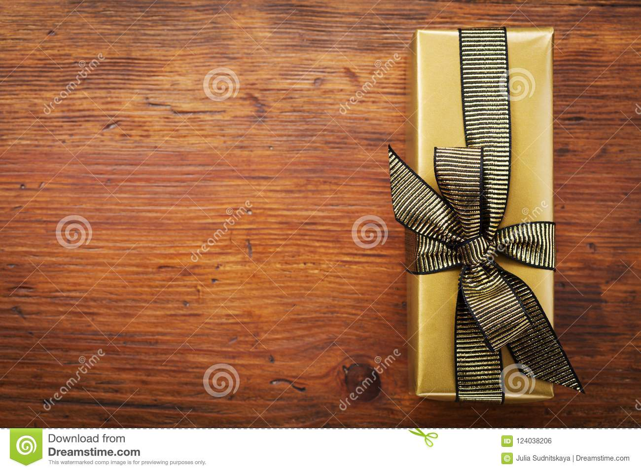 Gift Or Present Box Packed In Golden Paper On Wooden Table Top View Greeting Card For Christmas Birthday