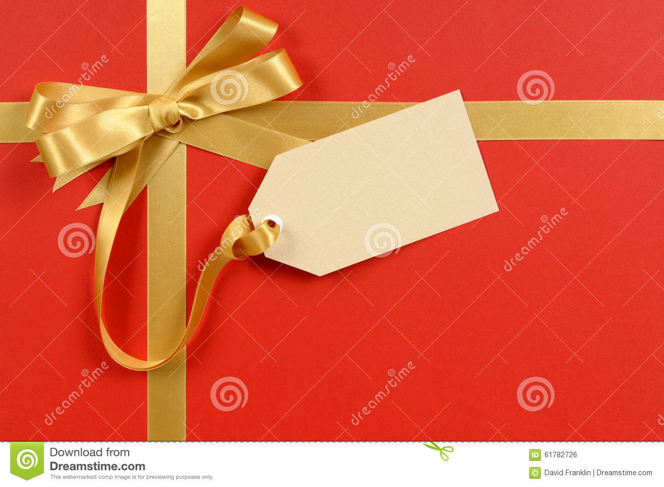 gift tag or label red background gold ribbon bow copy space