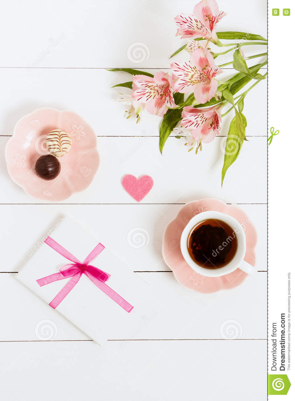 Gift to Valentine s Day, with tea and flowers on a white background. Top view, film effect